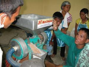 Demonstrating the adjustments on the rice mill